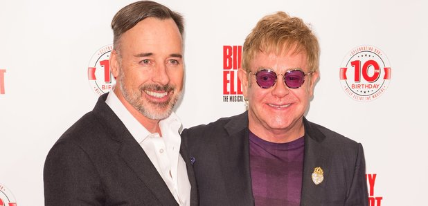 Sir Elton John and husband David Furnish attend th